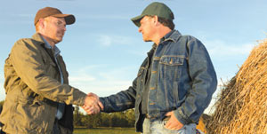 FRS Operator and farmer shaking hands in field